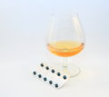 Drugs and alcohol glass of brandy strip of pills to depict the combination of medication Stock Images