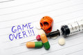 Drugs game over drug abuse concept on notebook Stock Image