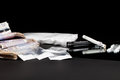 Drugs money. Cocaine dealer bags, cash and lines of coke. Royalty Free Stock Photo