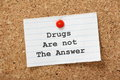 Drugs are not the answer in typescript on a lined paper note pinned to a cork notice board Stock Photo
