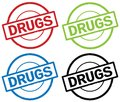 DRUGS text, on round simple stamp sign. Royalty Free Stock Photo