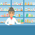 Drugstore pharmacist at the counter.