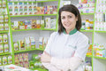 Drugstore young female pharmacist in a Royalty Free Stock Photo