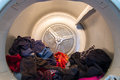 Drum of a dometstic tumble drier inside view domestic clothes with clothing in it Stock Photography