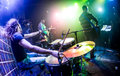 Drummer blurred motion playing on drum set on stage focus on the drum and microphone Stock Photo