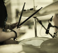 Drummer detail of a on the rock concert selective focus on hands Royalty Free Stock Photos