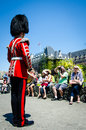 Drummer entertains the crowd on canada day wearing a historic british military uniform including a bearskin his head with Royalty Free Stock Photo
