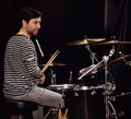 Drummer playing live on stage Stock Images