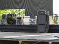 Drums set powerfull speakers amplifiers and stage equipment on Stock Photography