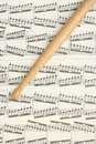 Drumstick and music sheet on the Stock Images