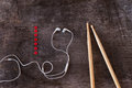 Drumsticks and earphones laid on a wooden desk background Stock Photo