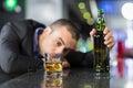 Drunk businessman slumped on bar Royalty Free Stock Photo