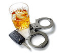 Drunk driving whiskey with car keys and handcuffs concept for drinking and Royalty Free Stock Photos