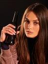 Drunk girl holding bottle of alcohol . Royalty Free Stock Photo