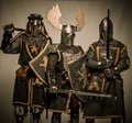 Drunk knights company of medieval in armour Stock Photography