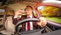 Drunk man driving a car vehicle in suit and sunglasses on road in the Royalty Free Stock Images