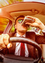 Drunk man driving a car vehicle in suit and sunglasses on road in the Royalty Free Stock Photo