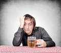 Drunk man holding the pint of beer Royalty Free Stock Images