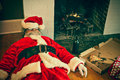 Drunk and passed out santa claus partied too hard at this house Royalty Free Stock Images