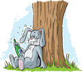 Drunk rabbit drunken who is leaning against a tree Stock Image