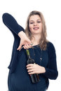 Drunk woman opening bottle of wine Stock Photography