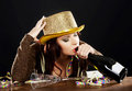 Drunk young woman celebrating new years eve on black background Stock Photo