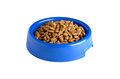 Dry cat food in blue bowl isolated on white Stock Photography