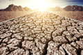 Dry cracked mud in waterless area Royalty Free Stock Photo