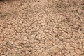 Dry cracked red soil Stock Photography