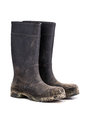 Dry dirty Mud boots isolated on white 3/4 view Royalty Free Stock Photo