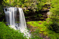 Dry falls in highlands nc in summer showing lush greenery and delicate water Stock Photography