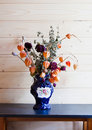 Dry flowers in a dark blue vase Royalty Free Stock Photos