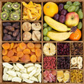 Dry and fresh fruit assortment in rustic wooden box Royalty Free Stock Photo