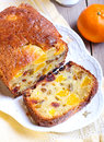Dry fruit and tangerine cake sliced Stock Photos