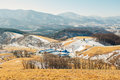 Dry grass field and mountain and snow and winter landscape in Daegwallyeong sheep ranch, Korea Royalty Free Stock Photo