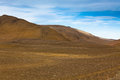 Dry gravel field mountains landscape under blue summer sky highlands central iceland Royalty Free Stock Images