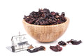 Dry Hibiscus in a wooden bowl Royalty Free Stock Photo