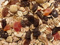 Dry muesli with fruits and nuts close up background Stock Photo