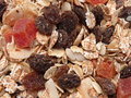 Dry muesli with fruits and nuts close up background Stock Images