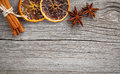 Dry orange cinnamon and star anise with copy space on wooden background Royalty Free Stock Image