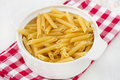 Dry pasta in the white bowl Royalty Free Stock Photography