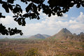 Dry plains and forested mountains at myanmar Stock Images