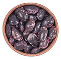 Dry purple beans in a wooden bowl Royalty Free Stock Photo