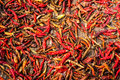 Dry red hot chili peppers at asian market organic food background Stock Photo