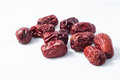 Dry red jujubes dates on white background Stock Images