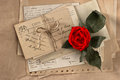 Dry red rose and old love letters vintage postcards envelopes vintage valentines day background Royalty Free Stock Images