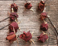 Dry rose on old board Royalty Free Stock Photos