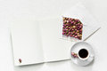 Dry roses in envelope and cup of tea with empty open copy book for text on white background, flat lay, overhead view, Royalty Free Stock Photo
