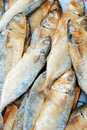 Dry salty fish close up heap in market Stock Photos