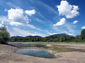 Dry shore in summer view of of liptovska mara lake near liptovsky trnovec with great choc mountain range visible background Royalty Free Stock Photography